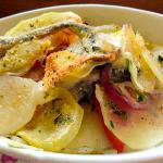 Alici gratinate con patate e cipolle