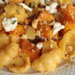 Gnocchi di pasta di semola con zucca, quartirolo, noci, zenzero e rosmarino