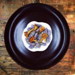 gnocchi di patata viola, fonduta di parmigiano e finferli