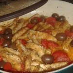 Pollo al parmigiano con pomodorini e olive
