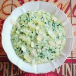 Risotto agli spinaci, zucchine mantecato allo stracchino e scaglie di Parmigiano e mandorle