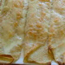 crespelle farcite e gratinate al formaggio morbido