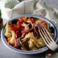 insalata di cavolfiore con peperoni e acciughe