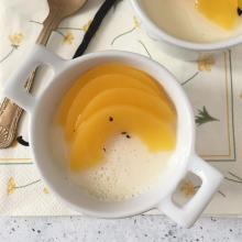 Panna cotta con pesche alla vaniglia