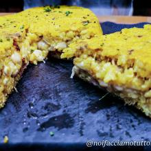 Timballo di riso con pollo, curcuma e pecorino