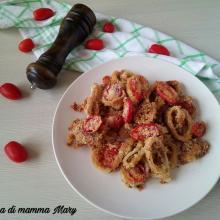 Anelli di totano gratinati al forno con pomodorini