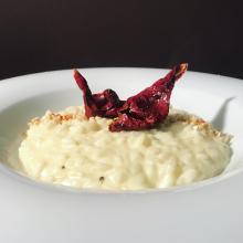 risotto in doppia mantecatura alla robiola, peperone crusco e granella di anacardi