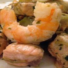 Spezzatino di salmone carciofi e mazzancolle